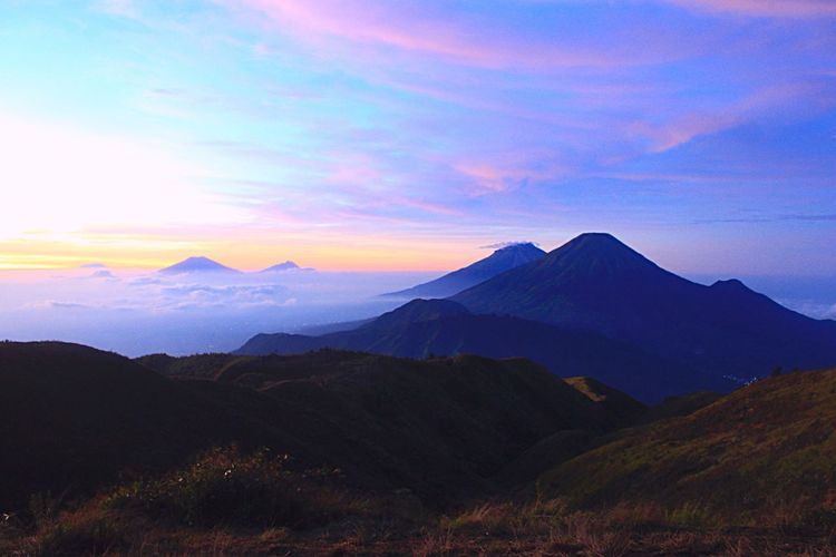 Scenic view of mountains range against sky during sunset