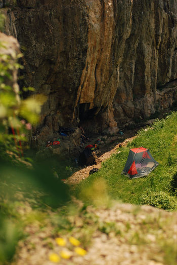 High angle view of a campsite of mountain climbers. Active Lifestyle  Alpine Backpacking Beauty In Nature Camping Camping Out Campsite Climbing Freedom Gear Green High Angle View Hills Leisure Activity Mountaineering Nature Outdoors Peaceful RockClimbing Spring Steep Summer Tent Tourism Vacations