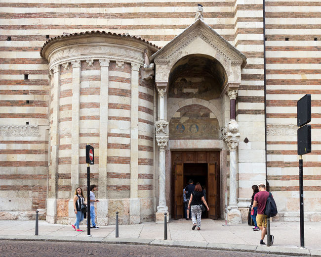 Verona, Italy - September 26, 2015 : Visitors enter the Duomo Cattedrale di S. Maria Matricolare cathedral through the side entrance in Verona, Italy Adige River Ancient Architecture Arena Art Building Castelvecchio Castle City Culture Famous Heritage Historic Historical House Italian Italy Landmark Scaligero Time Tourism Travel Vacation Verona World