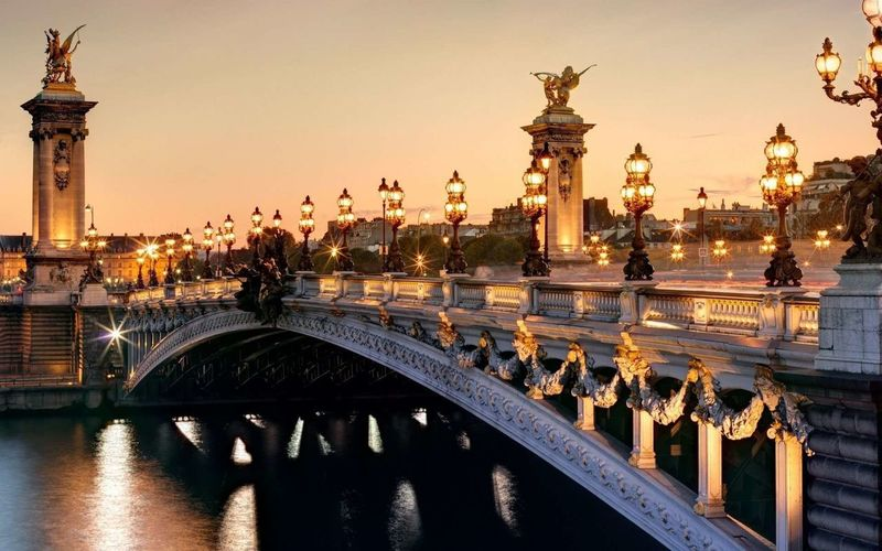 Illuminated Pont Alexandre Iii Over Seine River Against Clear Sky