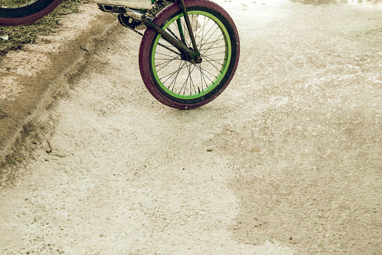 Low section of bicycle on dirt road