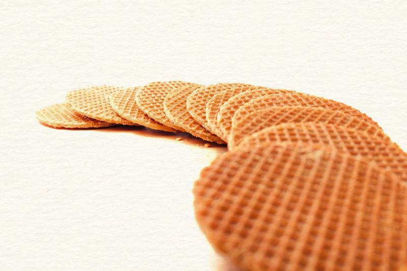 Stroopwafels - Dutch Syrup Waffles Gourmet Dutch Waffle Bakery Baked Snack Sweet Crispy Cookie Caramel Syrup Waffle Holland Netherlands Biscuits Stroopwafel Dutch Food Dutch Textile Indoors  Close-up No People Single Object Wool Pattern Orange Color Still Life White Background High Angle View