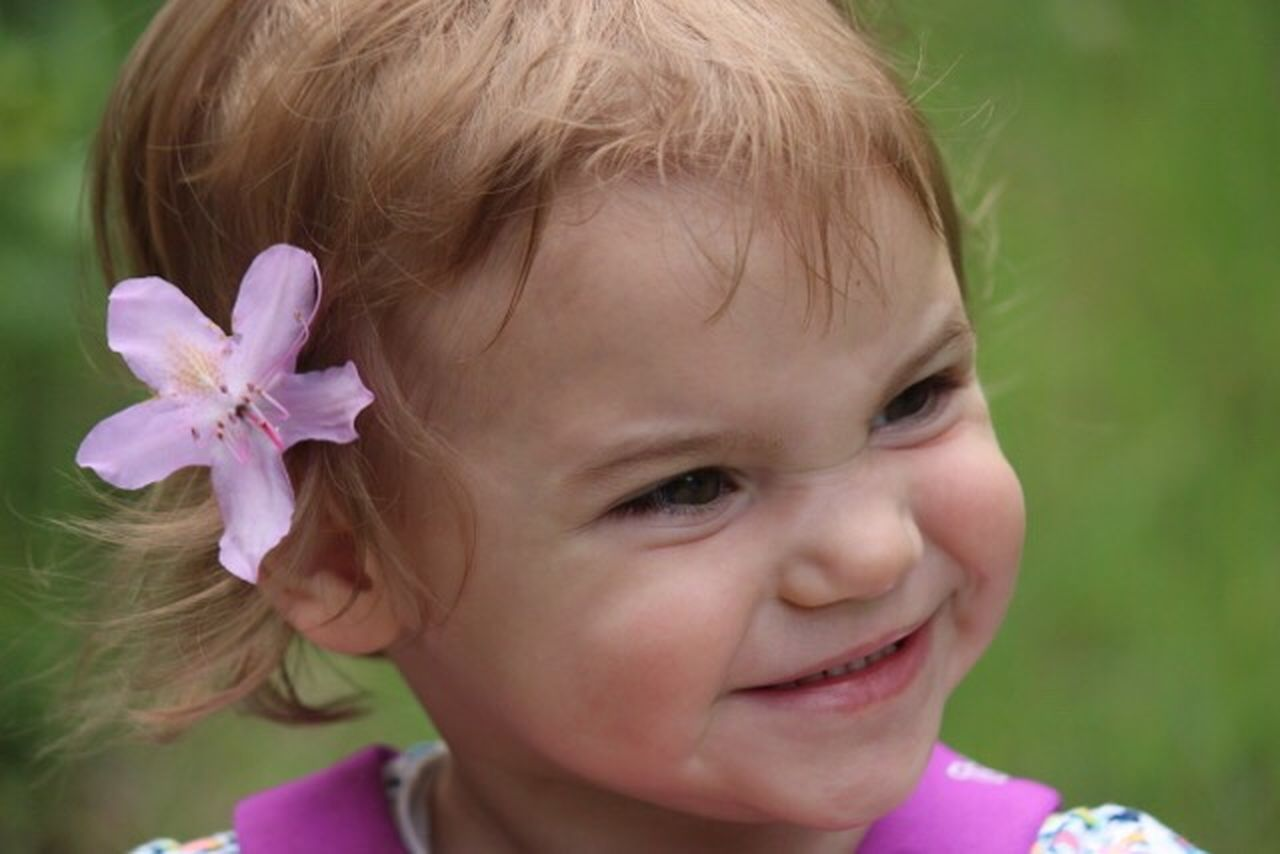 innocence, childhood, baby, headshot, flower, close-up, cute, one person, focus on foreground, babies only, blond hair, fragility, day, outdoors, smiling, people, nature, flower head