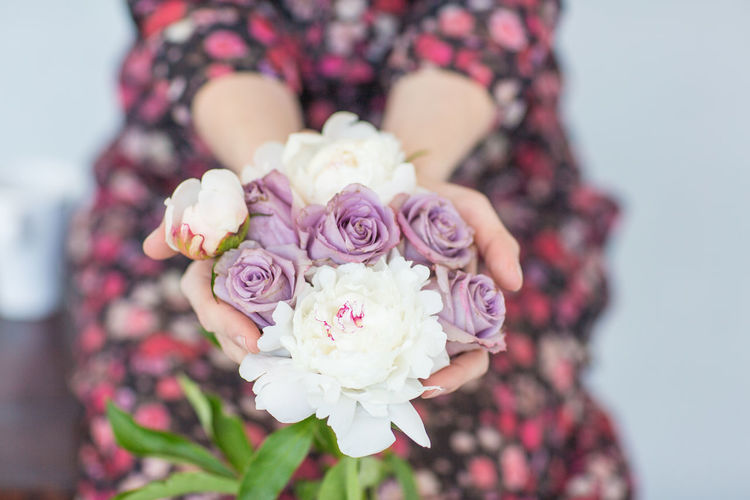 Beauty In Nature Bouquet Bride Celebration Close-up Day Flower Flower Head Focus On Foreground Fragility Freshness Holding Life Events Midsection Nature One Person Outdoors Peony  Petal Pink Color Real People Rose - Flower Wedding Wedding Dress Women