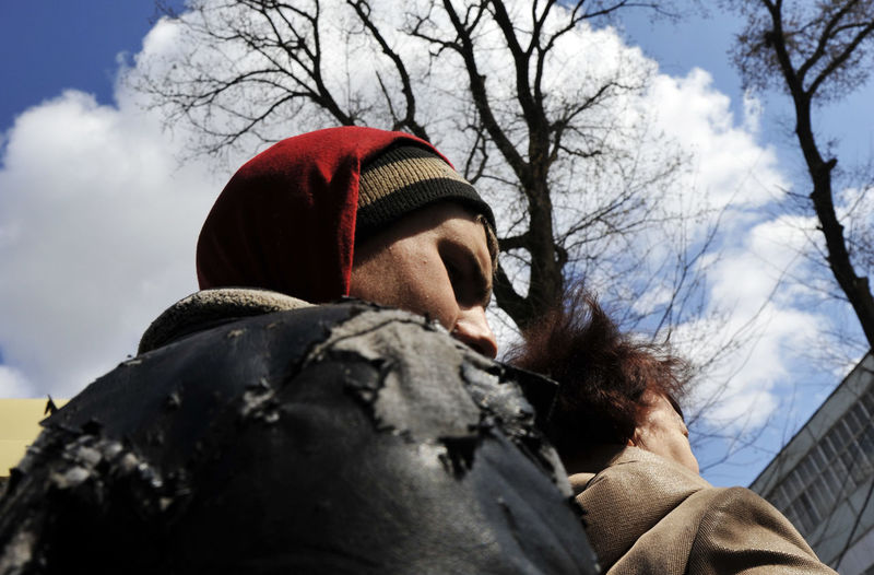 Low angle portrait of man against sky during winter
