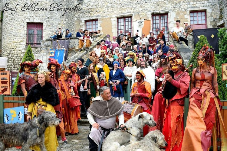 Nemours NemoursMedieval Large Group Of People Dog Crowd Mixed Age Range Performance Spectator Day Architecture Pets Men Built Structure Outdoors Arts Culture And Entertainment People Building Exterior City Domestic Animals Women Adult Period Costume