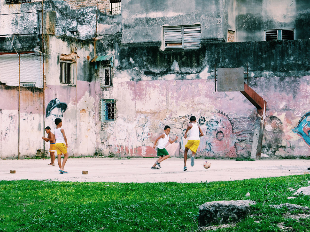 full length, graffiti, building exterior, running, built structure, outdoors, lifestyles, architecture, day, leisure activity, exercising, young adult, real people, sport, young women, sports clothing, men, city, adult, friendship, people, sportsman, adults only, ghetto