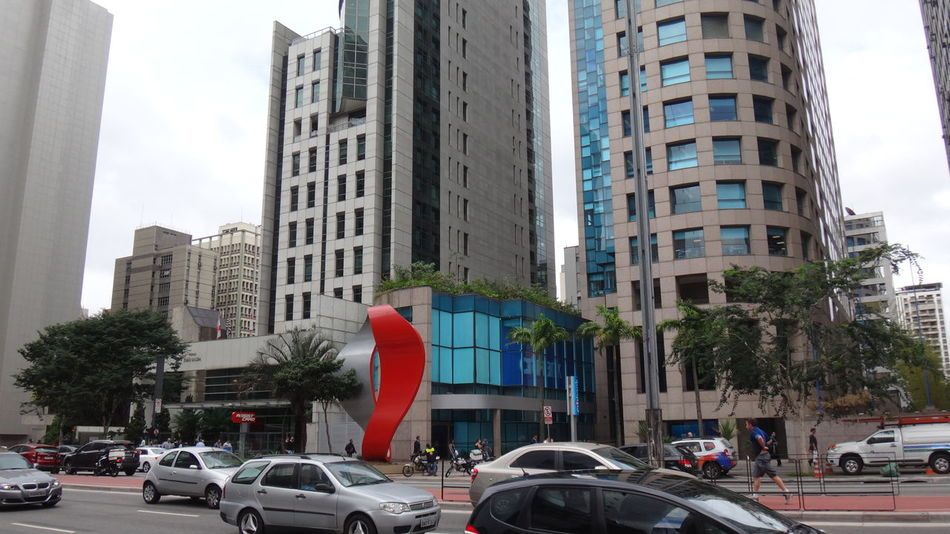PAULISTA AVENUE SAO PAULO BRAZIL MAIO 2016 Architecture Building Building Exterior Built Structure City City Life City Street Day EyeEm Team Land Vehicle Mode Of Transport Modern No People Office Building Outdoors Parked Parking Road Sky Stationary Street Tall - High Traffic Transportation Tree