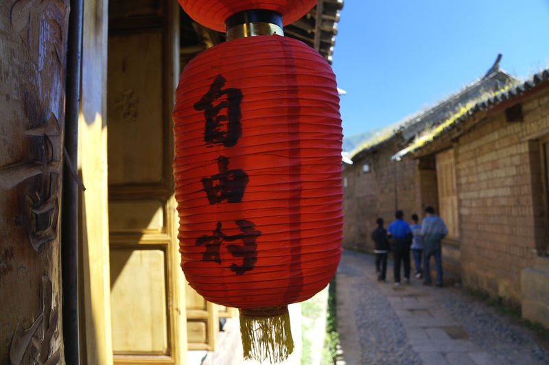 Architecture Building Exterior Built Structure Celebration China Chinese Culture Chinese Lantern Cultures Day Hanging Lantern Men Outdoors People Place Of Worship Real People Red Religion Shaxi Sky Spirituality Tea Horse Road Text Women Yunnan