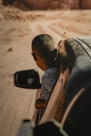 Rear view of man photographing