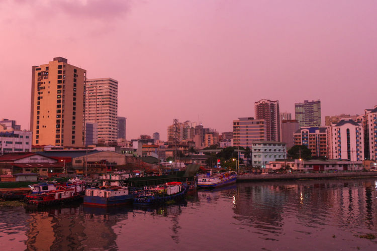 River Harbor by Dusk Skyporn See What I See Skyscraper Buildings River River View River Ferry Passenger Ferry Ferry Station Manila ManilaStreetPhotography Pasig River Dusk In The City Dusk Dusk In Manila DSLR Canonphotography Outdoors No People Urban Skyline Cityscape City Life Reflections In The Water Reflection Tower Office Building Tall Skyline High Rise City Location