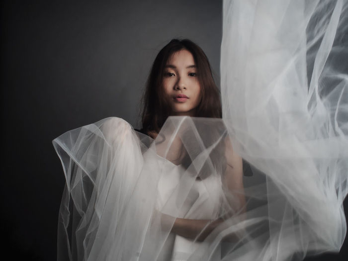 Adult Beautiful Girl Beautiful Woman Beauty Black Background Black Hair Bride Day Front View Gorgeous Headshot Indoors  One Person People Portrait Studio Studio Photography Wedding Wedding Dress White Color Woman Women Women Who Inspire You Young Adult Young Women