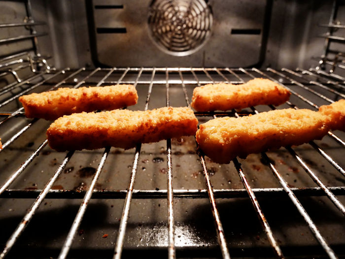 Close-up of fish fingers in oven