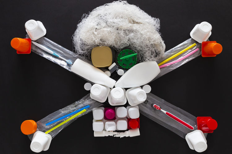 Close-up of toys on table against black background