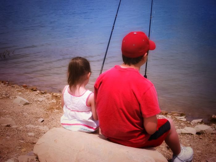 Live For The Story Sitting Real People Water Rear View Two People Shore Childhood Outdoors Nature Leisure Activity Day Togetherness The Great Outdoors - 2017 EyeEm Awards Fishing