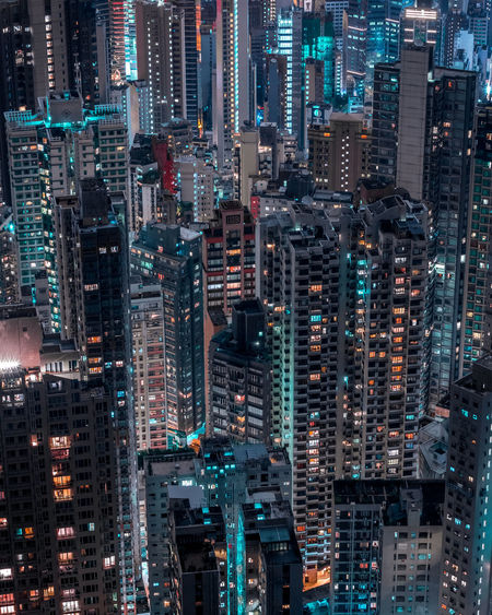 High angle view of illuminated buildings in city