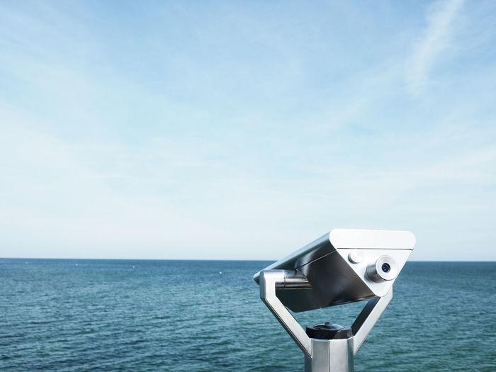 Binoculars on a seabridge, conceptual image of farsightedness Beauty In Nature Binoculars Blue Cloud - Sky Coin Operated Day Farsightedness Horizon Horizon Over Water Nature No People Non-urban Scene Outdoors Scenics - Nature Sea Seabridge Sky Surveillance Tranquil Scene Tranquility Water
