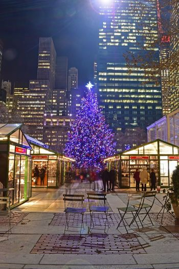Night Illuminated Tree Building Exterior Architecture Built Structure Outdoors Real People City Large Group Of People Sky People Nightphotography NYC Christmas Decorations Christmas Time Christmas Ornament Christmas Market Bryant Park NYC Bryantpark NYC Photography Tree Christmas Tree Christmas Decoration Christmas Lights