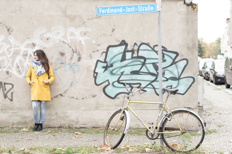 Pauline CyclingUnites Bicycle Bike Street Streetphotography Streetart Street Fashion Street Art Street Photography One Girl Only Girl Woman Female Femme Portrait Portrait Of A Woman Portrait Photography One Person Spray Paint Grafitti Outdoors Fashion Leipzig Sachsen Germany Women Around The World Art Is Everywhere The Portraitist - 2017 EyeEm Awards Mobility In Mega Cities Stories From The City Adventures In The City