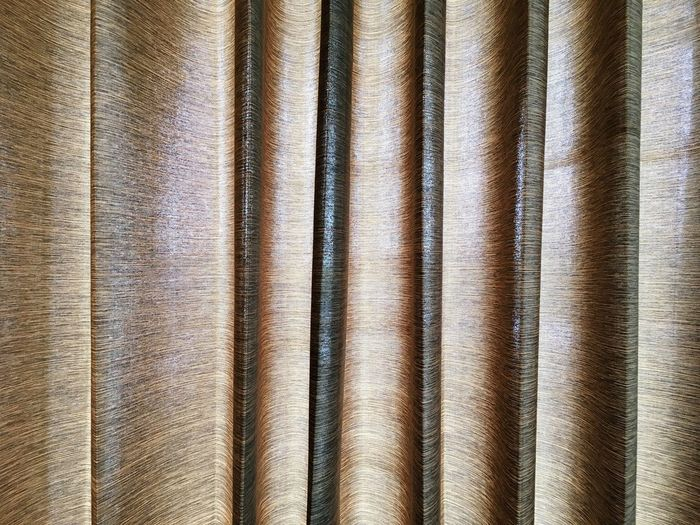EyeEm Selects fabric curtain Backgrounds In A Row Full Frame Textured  Textile Textile Industry Pattern No People Industry Close-up Day Indoors  Corrugated Iron Fabric Curtain Fabrication Fabric Cutting Brown Lines And Shapes Folded Curtain Plaits Folding Curtains Translucent Sunshade