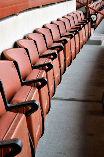 In A Row Seat Indoors  Chair No People Absence Large Group Of Objects Order Empty Arrangement Repetition High Angle View Brown Table Still Life Sport Auditorium Close-up Side By Side Bleachers Stadium Stadium Seating Stadium Seats Burnt Orange College Football