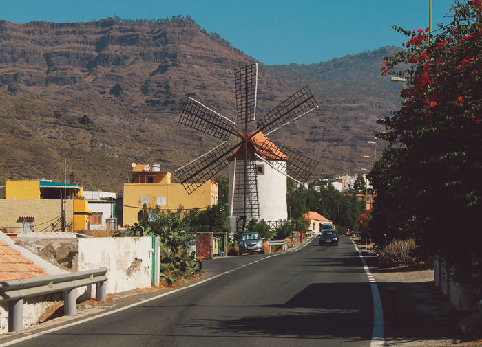 Traditional Windmill Against Mountain