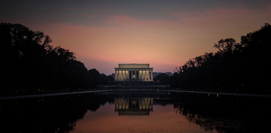 Reflection Of Lincoln Memorial In Pool At Sunset