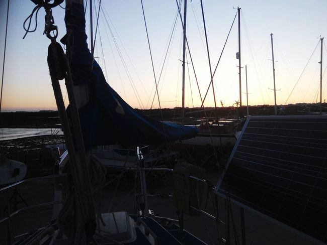 City Sunset Water Sky Amusement Park Ride Coast Horizon Over Water Moored Boat Wave Rushing Evening Outrigger Longtail Boat Shore Ocean Chain Swing Ride Silhouette Calm Fishing Boat Dusk Waterfront Nautical Vessel Mast Harbor