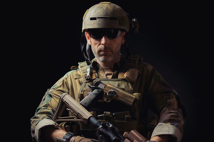 special forces soldier of the united states poses with a rifle on a black background American Elite Gun Soldier Uniform Armed Army Assault Rifles Commando Firearms Forces Infantry Marines Military Navy Operator Ranger Rifle Special Troops Us War Warfare Warior Weapon First Eyeem Photo