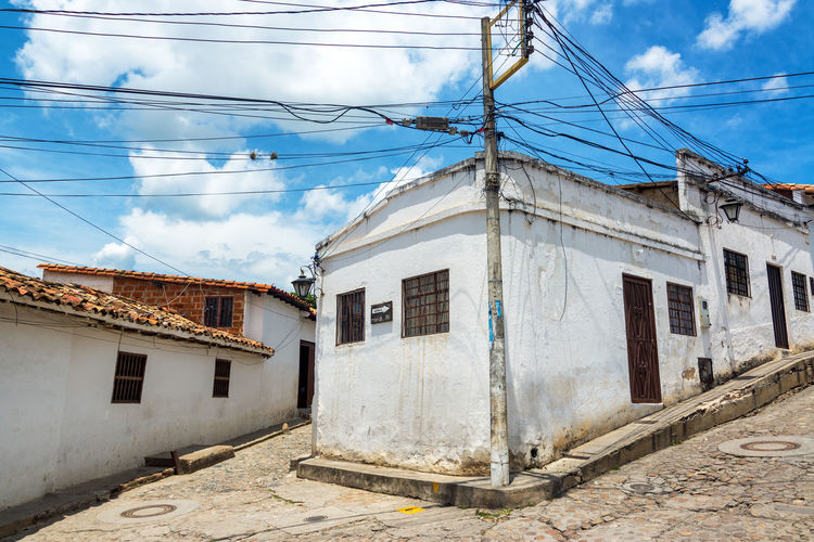 Street corner in Giron, Colombia City Cloud Colombia Houses Santander Architecture Blue Sky Bucaramanga Building Building Exterior Built Structure Cable Cloud - Sky Cobblestone Colonial Colonial Architecture Corner Day Girón House Outdoors Sky Street Style Town