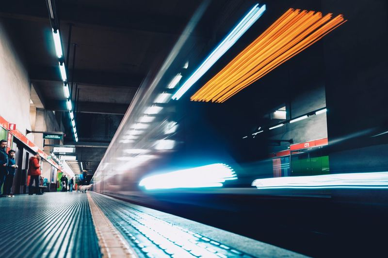 Illuminated Architecture Built Structure Transportation Motion Blurred Motion Night Outdoors The Way Forward City Life Travel Sign Public Transportation Mode Of Transportation Lighting Equipment Building Exterior Ceiling Incidental People City Real People