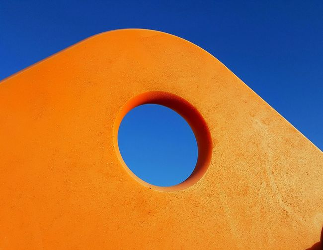Blue Circle Orange Color Geometric Shape Clear Sky Built Structure Blue And Orange Vibrant Color Abstract Art Abstract Concentric Sky Hole View Through A Hole Blue Sky And Orange