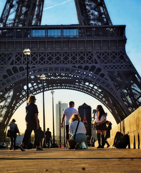 People Cityscape City Life Streetphotography Paris, France  Tourist Attraction  Summer Vibes Eiffel Tower Paris Pont D'Iéna Morning Light This Morning City Women Men Sky Architecture Building Exterior Built Structure Travel Urban Skyline Urban Scene City Gate City Location Historic Summer In The City