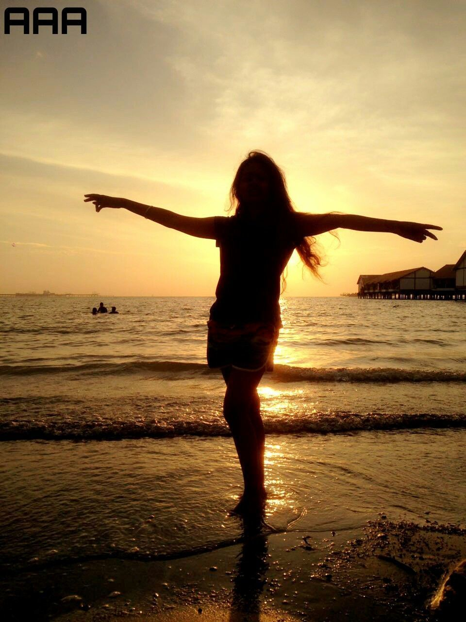 sunset, sea, arms outstretched, beach, beauty in nature, silhouette, nature, water, one person, real people, tranquil scene, scenics, full length, horizon over water, sky, lifestyles, leisure activity, outdoors, standing, women, young adult, energetic, human hand, adult, day, people