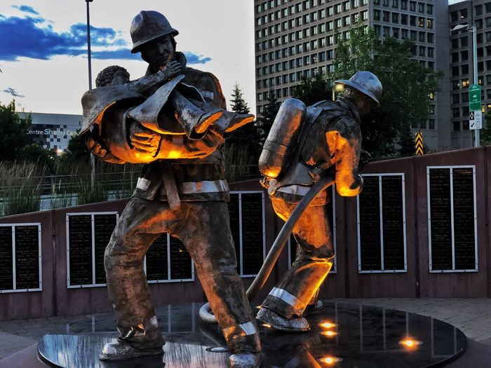 Firefighters memorial Streetphotography Visualpoetry Urbanphotography Building Exterior Architecture Built Structure City Sculpture Nature Fire Illuminated Statue Representation Outdoors Human Representation