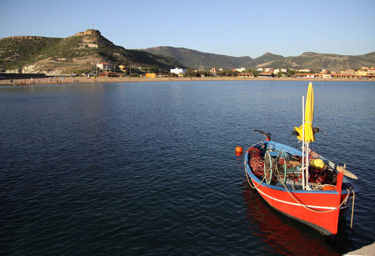 Sardinia Coast Costaline Sardinia Sardegna Italy  Architecture Beauty In Nature Blue Built Structure Clear Sky Craft Fishing Boat Day Moored Mountain Mountain Range Nature Nautical Vessel No People Outdoors Scenics Sea Seascape Sky Tranquility Transportation Travel Destinations Water Waterfront
