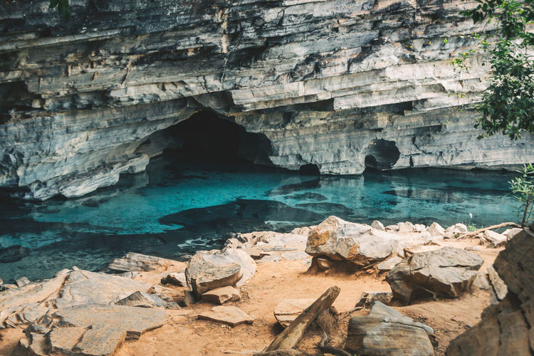 Exploring the beautiful caves, lagunas and waterfalls of Chapada Diamantina. Beauty In Nature Blue Cave Cliff Day Discover  Explore Geology Natural Arch Nature No People Outdoors Physical Geography Rock Rock - Object Rock Formation Rocks And Water Scenics Sky Tranquil Scene Tranquility Travel Travel Destinations Traveling Water EyeEm Selects Going Remote This Is Latin America The Great Outdoors - 2018 EyeEm Awards