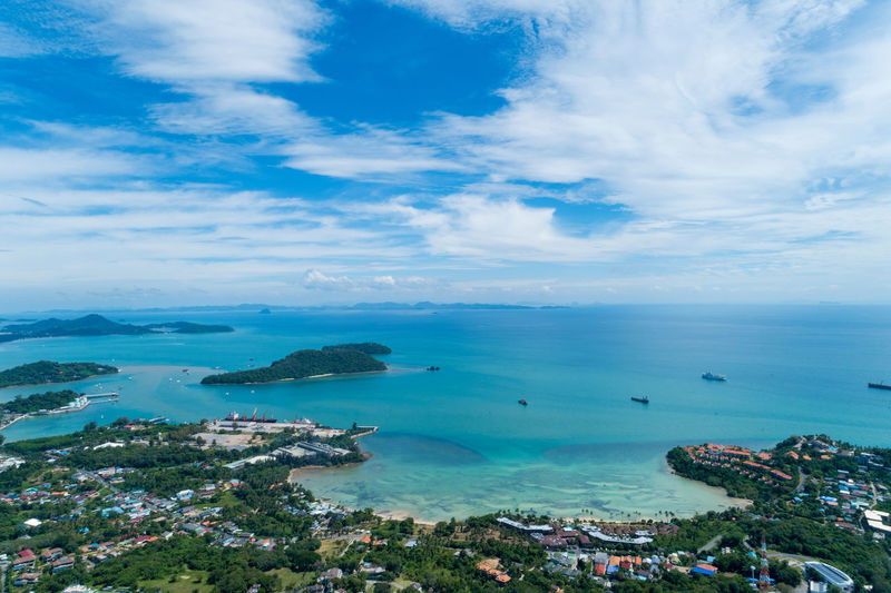High angle view of bay against cloudy sky