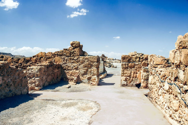 Stone Walls At Masada Against Blue Sky