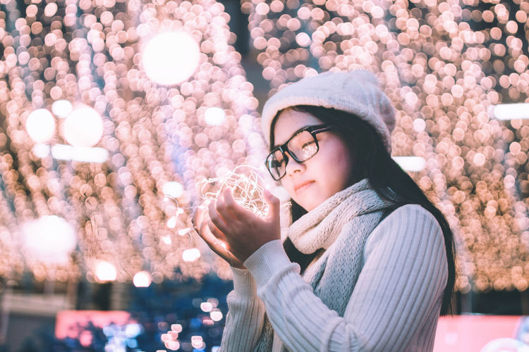 You are the best christmas gift. Christmas Christmas Around The World Christmas Lights Light Beautiful Woman Christmas Decoration Christmas Decorations Christmas Ornament Christmas Tree Christmastime Eyeglasses  Focus On Foreground Glasses Illuminated Leisure Activity Lifestyles Night One Person Outdoors Real People Standing Warm Clothing Winter Young Adult Young Women