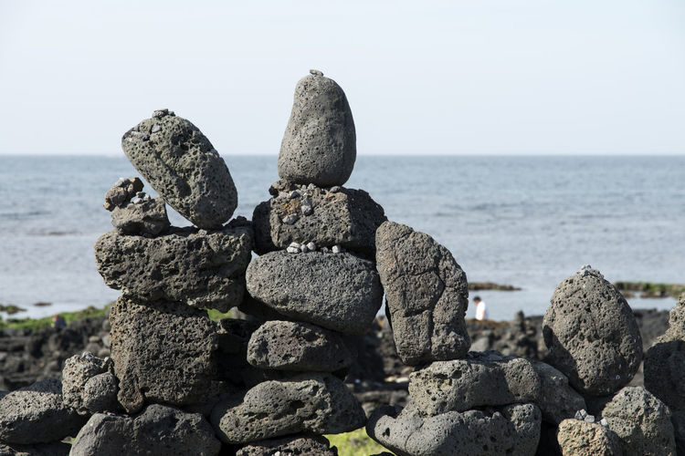 seaside view of stone stack at Gujwaup in Jeju Island, South Korea Beach Beauty In Nature Clear Sky Close-up Coastline Day Gujwaup Horizon Over Water JEJU ISLAND  Nature No People Outdoors Rock Rock - Object Rock Beach Scenics Sea Seaside Sky Stone Stack Tranquil Scene Tranquility Water
