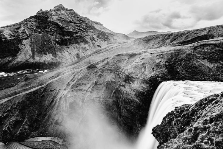 Skógafoss Iceland Tourist Attraction  Beauty In Nature Black And White Contrast Day Geology Landmark Landscape Mist Motion Mountain Mountain Range Nature No People Outdoors Rock - Object Scenics Skogafoss Tourism Travel Destinations View From Above Water Waterfall
