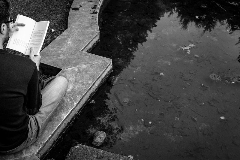 Monochrome Photography Low Section Street Road Puddle Person Reflection High Angle View Lifestyles Men Collection Limb Day Outdoors Book Reading A Book