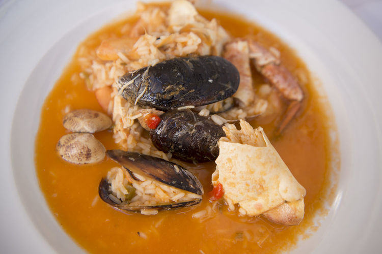Close-up of seafood curry served in plate on table