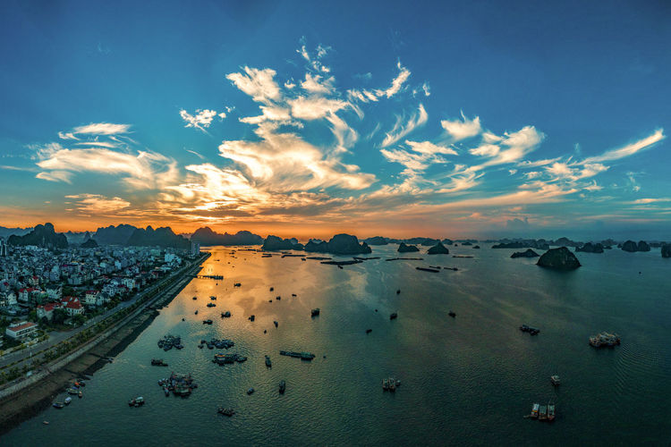 Sunrise in Ha Long city Sky Cloud - Sky Water Beauty In Nature Scenics - Nature Sea Nature Tranquil Scene Tranquility Nautical Vessel Transportation Horizon No People High Angle View City Beach Idyllic Outdoors Fishing Boat Sunrise