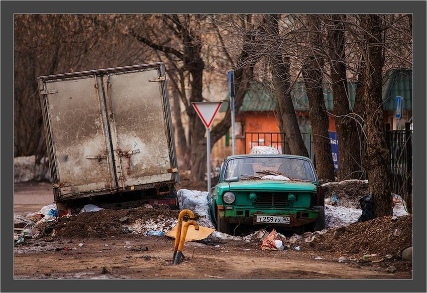 Still Life StillLifePhotography Street Photography Streetphotography City Life City Residential Structure Land Vehicle Damaged In Front Of Group Of Objects Bad Condition Day Outdoors Spring Spring Has Arrived Spring Is Coming  Corrugated Iron Canon 5d Mark ıı Canon EF 100-400 L IS USM