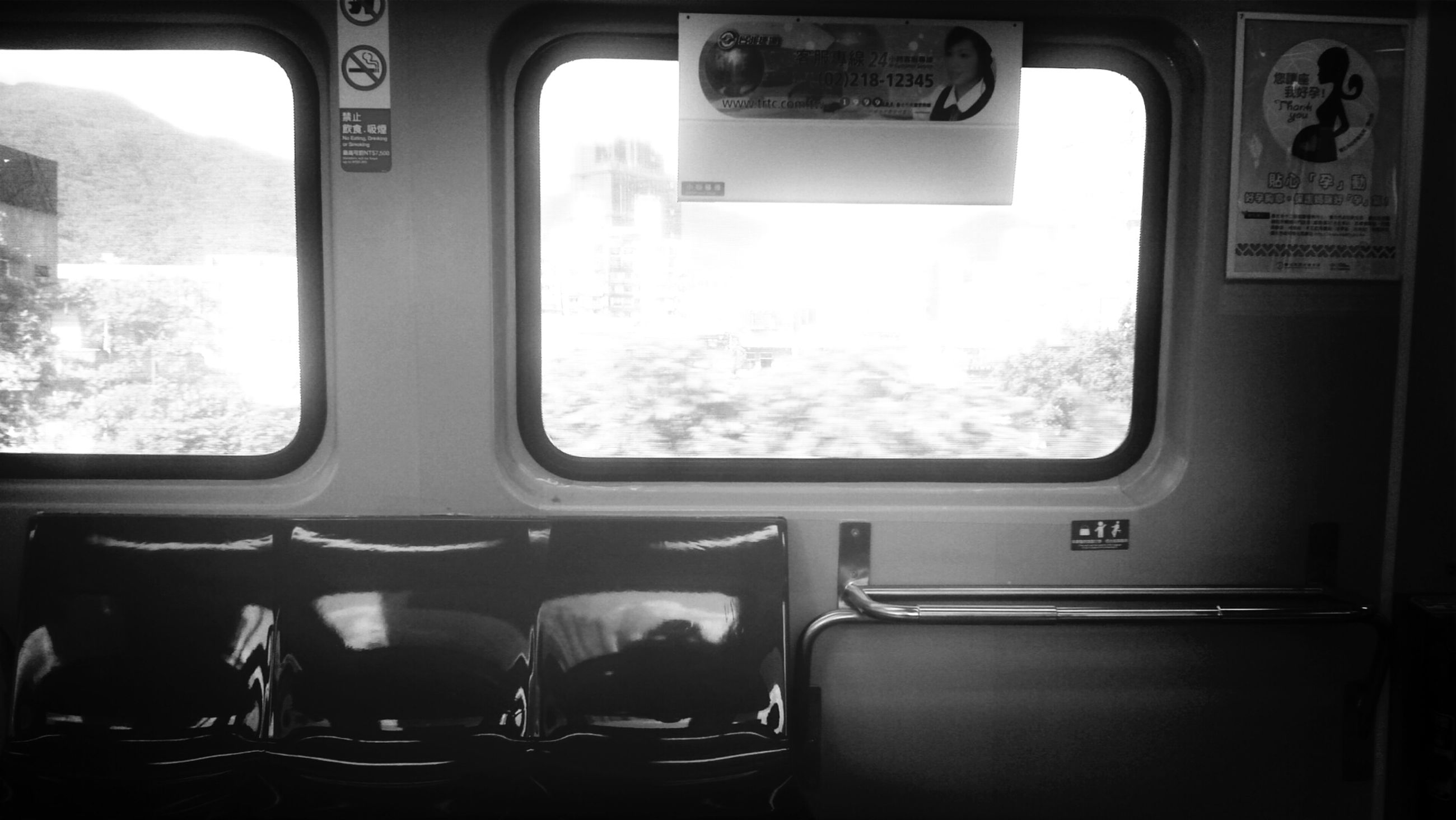 indoors, window, transportation, vehicle interior, mode of transport, glass - material, car, transparent, land vehicle, seat, public transportation, vehicle seat, absence, empty, chair, travel, train - vehicle, no people, day, interior