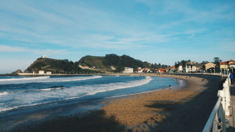 Ribadesella, Asturias. Beach Sea Water Shore Tranquil Scene City Scenics Sand Sky Coastline Vacations Building Exterior Blue Tranquility Travel Destinations Cloud - Sky Tourism Beauty In Nature Promenade Nature