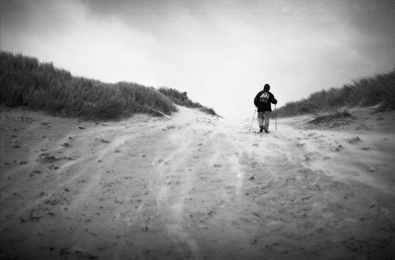 Full length of man walking on sand