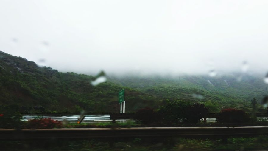 Fog Rain Tree Sky Transportation Rainy Season No People Nature Outdoors Water Architecture Mountain Day Freshness Street Photography Thunderstorm Rainy Sunday Travel Photography Green Nature Misty Mountains  Glistening Droplet Nature Windowview